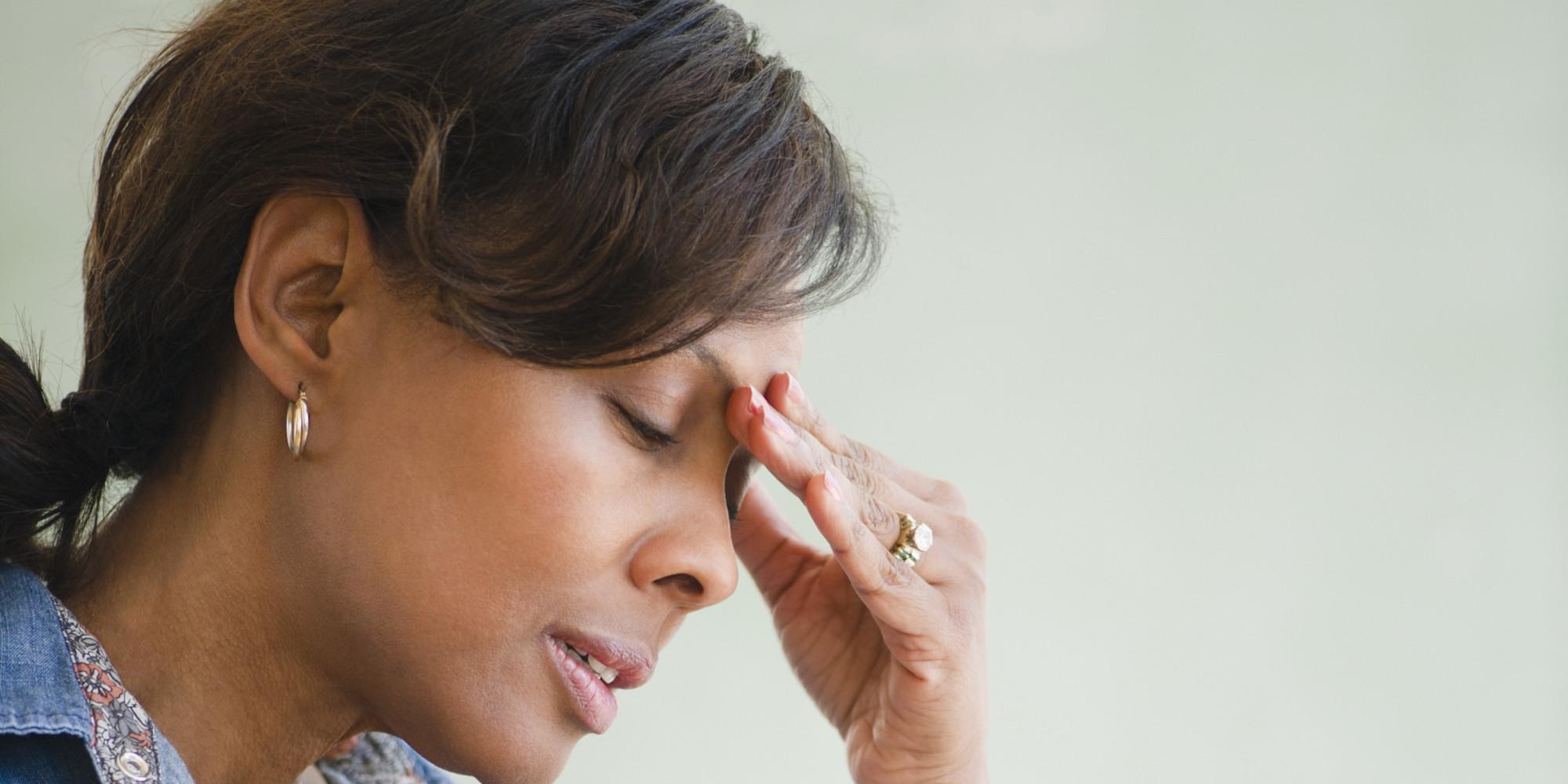 Black teacher in classroom with headache